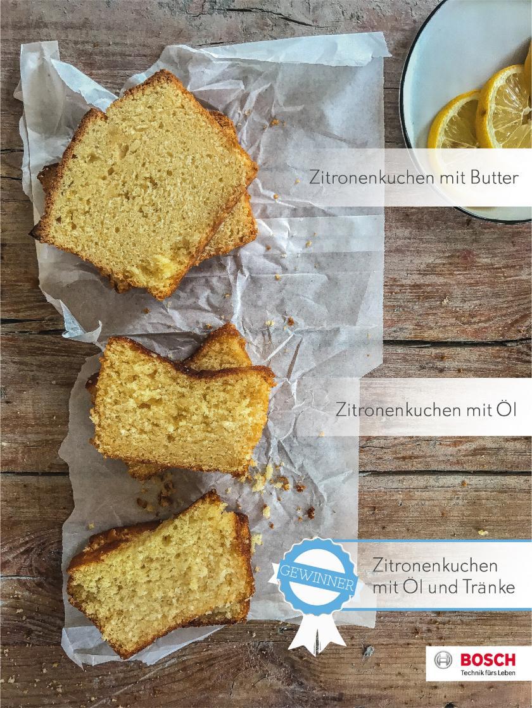 Drei Stücke Zitronenkuchen horizontal auf Backpapier aufgereiht.
